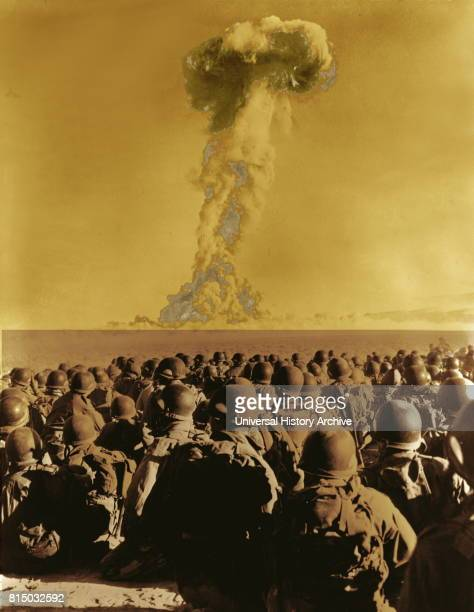 Nevada Frenchman's Flat members of 11th AB Div kneel on ground as they watch mushroom cloud of atomic bomb test 1951