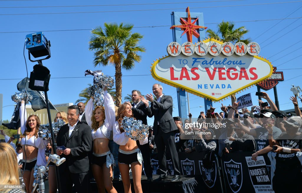 Nevada Gov. Brian Sandoval (L, front) announces David Sharpe of Florida as the Oakland Raiders' fourth-round draft pick in the 2017 NFL Draft at the Welcome to Fabulous Las Vegas sign on April 29, 2017 in Las Vegas, Nevada. National Football League owners voted in March to approve the team's application to relocate to Las Vegas. The Raiders are expected to begin play no later than 2020 in a planned 65,000-seat domed stadium to be built in Las Vegas at a cost of about USD 1.9 billion.