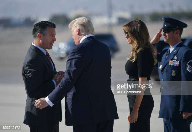Nevada Governor Brian Sandoval greets US President Donald Trump and First Lady Melania Trump upon their arrival at McCarran International Airport in...