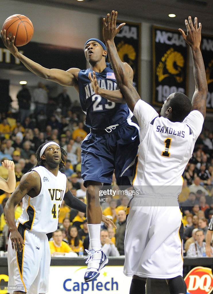 Nevada guard Armon Johnson (23) drives between Virginia Commonwealth University defenders T.J. Gwynn, left, and Larry Sanders (1) during the first half at the Stuart Siegel Center in Richmond, Virginia, Friday, November 27, 2009. VCU defeated Nevada, 85-76.