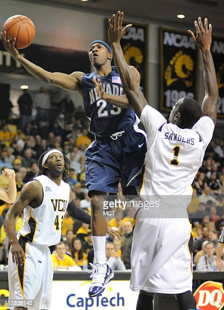 Nevada guard Armon Johnson drives between Virginia Commonwealth University defenders TJ Gwynn left and Larry Sanders during the first half at the...