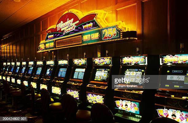 USA, Nevada, Las Vegas, row of slot machines in casino
