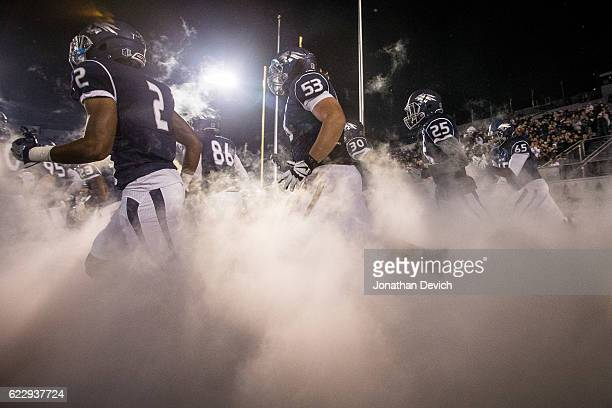 Nevada players run onto the field for tonights game against San Diego tonight at Mackay Stadium on November 12 2016 in Reno Nevada
