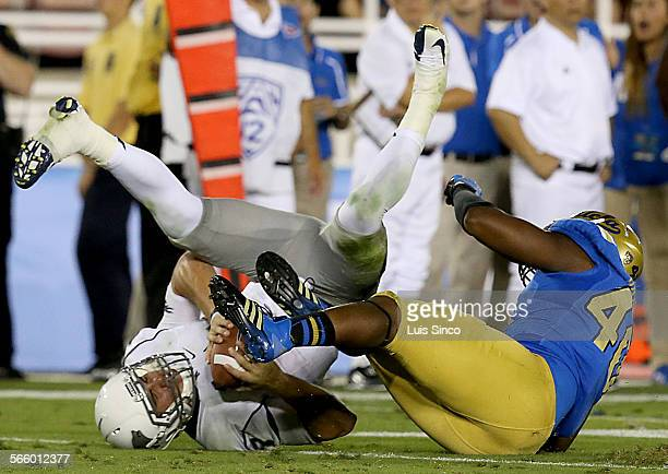 Nevada quarterback Cody Fajardo is sacked by UCLA defensive end Keenan Graham in the third quarter Saturday Aug 31 at the Rose Bowl in Pasadena