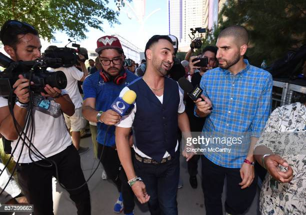 Nevada United States 22 August 2017 Paul Malignaggi is interviewed by journalist Ariel Helwani as he leaves the Grand Arrival at Toshiba Plaza in Las...