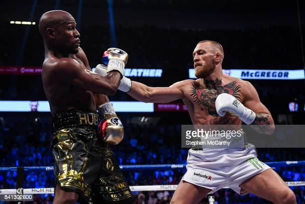 Nevada United States 26 August 2017 Conor McGregor right and Floyd Mayweather Jr during their super welterweight boxing match at TMobile Arena in Las...