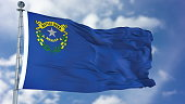 Nevada (U.S. state) flag waving against clear blue sky, close up, isolated with clipping path mask luma channel, perfect for film, news, composition