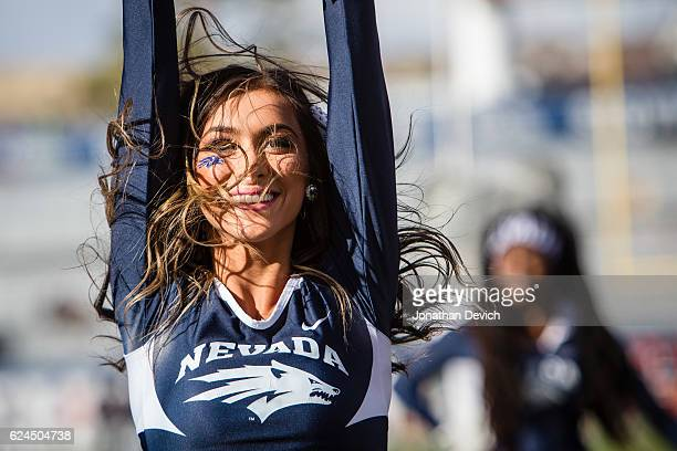 Nevada Wolf Pack cheerleader cheers before the game with the Utah State Aggies at Mackay Stadium on November 19 2016 in Reno Nevada