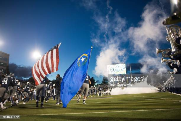 Nevada Wolf Pack players take the field carrying the American and Nevada state flags before the game between the Nevada Wolf Pack and the Air Force...