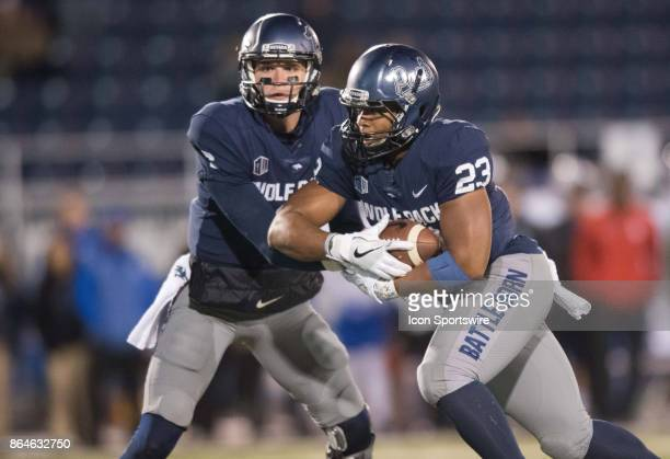 Nevada Wolf Pack quarterback Ty Gangi hands the ball off to Nevada Wolf Pack running back Kelton Moore during the game between the Nevada Wolf Pack...
