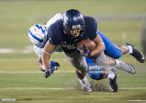 Nevada Wolf Pack wide receiver Andrew Celis is tackled by Air Force Falcons linebacker RJ Jackson during the game between the Nevada Wolf Pack and...