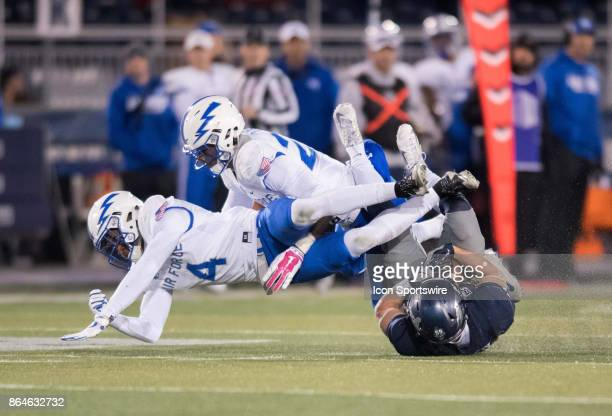 Nevada Wolf Pack wide receiver McLane Mannix tries to hold on to the ball while colliding with Air Force Falcons defensive back James Jones and Air...