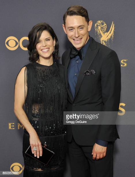 Neve Campbell and JJ Feild arrive at the 69th Annual Primetime Emmy Awards at Microsoft Theater on September 17 2017 in Los Angeles California