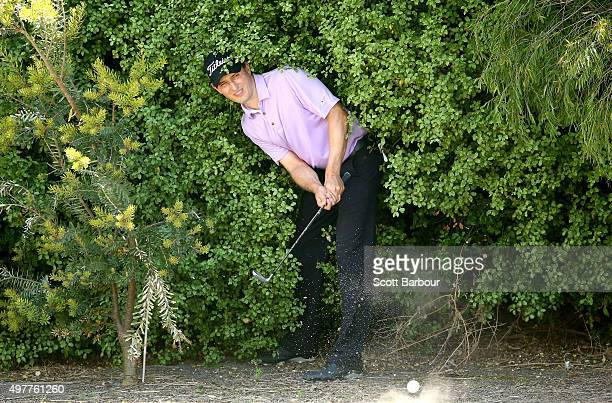 Neven Basic of Australia plays out of the trees on th 17th hole during day one of the 2015 Australian Masters at Huntingdale Golf Course on November...