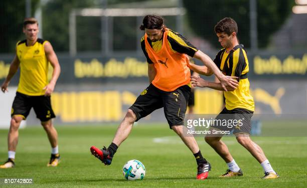 Neven Subotic and Christian Pulisic of Dortmund during a training session at BVB trainings center on July 7 2017 in Dortmund