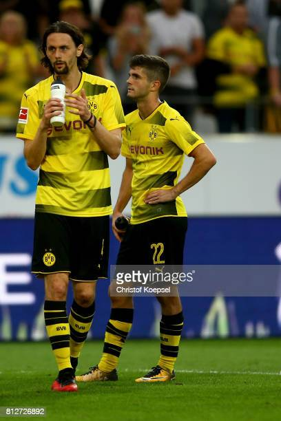 Neven Subotic and Christian Pulisic of Dortmund look dejected after the preseason friendly match between RotWeiss Essen and Borussia Dortmund at...