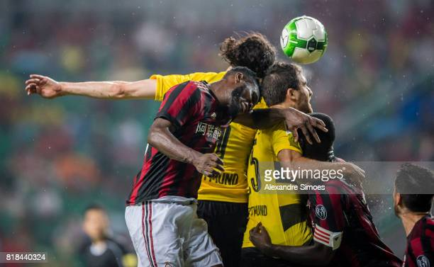 Neven Subotic and Sokratis Papastathopoulos of Borussia Dortmund in action during a preseason friendly match between AC Milan and Borussia Dortmund...