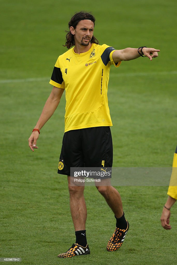 Neven Subotic directs his teammates during a training session in the Borussia Dortmund training camp on July 31, 2014 in Bad Ragaz, Switzerland.