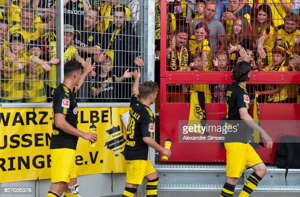 Neven Subotic JanniLuca Serra and Felix Passlack of Borussia Dortmund together with the fans after the final whistle during the preseason friendly...