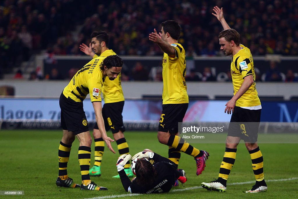 <a gi-track='captionPersonalityLinkClicked' href=/galleries/search?phrase=Neven+Subotic&family=editorial&specificpeople=2234315 ng-click='$event.stopPropagation()'>Neven Subotic</a>, <a gi-track='captionPersonalityLinkClicked' href=/galleries/search?phrase=Nuri+Sahin&family=editorial&specificpeople=609186 ng-click='$event.stopPropagation()'>Nuri Sahin</a>, <a gi-track='captionPersonalityLinkClicked' href=/galleries/search?phrase=Sokratis+Papastathopoulos+-+Soccer+Player&family=editorial&specificpeople=4426771 ng-click='$event.stopPropagation()'>Sokratis Papastathopoulos</a> and <a gi-track='captionPersonalityLinkClicked' href=/galleries/search?phrase=Marcel+Schmelzer&family=editorial&specificpeople=5443925 ng-click='$event.stopPropagation()'>Marcel Schmelzer</a> (L-R) of Dortmund react as goalkeeper <a gi-track='captionPersonalityLinkClicked' href=/galleries/search?phrase=Roman+Weidenfeller&family=editorial&specificpeople=726753 ng-click='$event.stopPropagation()'>Roman Weidenfeller</a> lies on the ground during the Bundesliga match between VfB Stuttgart and Borussia Dortmund at Mercedes-Benz Arena on February 20, 2015 in Stuttgart, Germany.