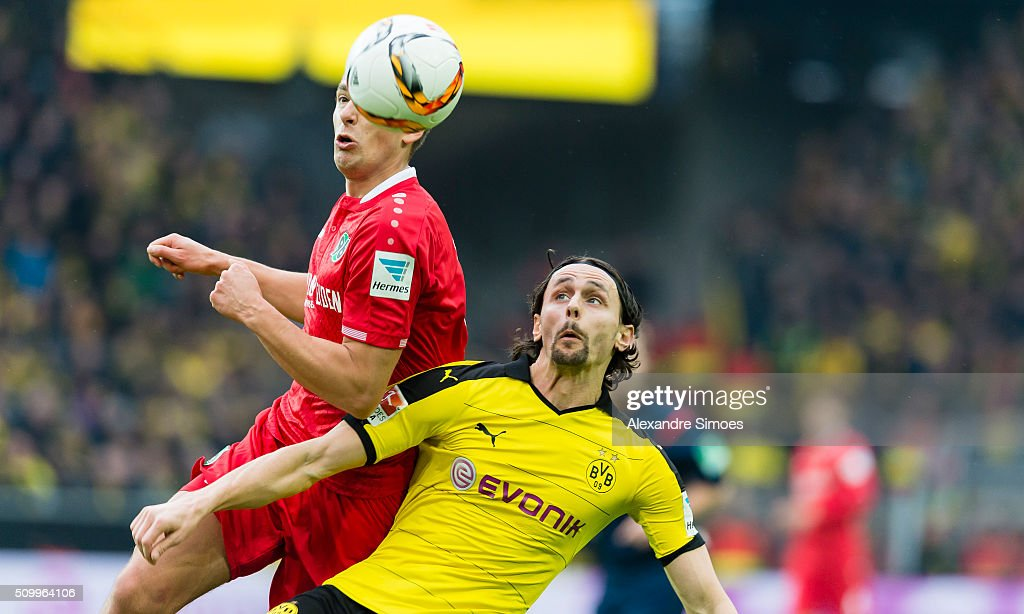 Neven Subotic of Borussia Dortmund challenges Artur Sobiech of Hannover in an aerial duel during the Bundesliga match between Borussia Dortmund and Hannover 96 at Signal Iduna Park on February 13, 2016 in Dortmund, Germany.
