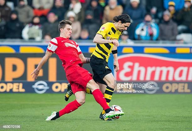 Neven Subotic of Borussia Dortmund challenges Maximilian Philipp of Freiburg during the Bundesliga match between SportClub Freiburg and Borussia...