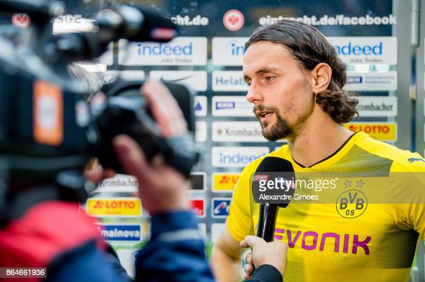 Neven Subotic of Borussia Dortmund gives an interview after the final whistle during the Bundesliga match between Eintracht Frankfurt and Borussia...