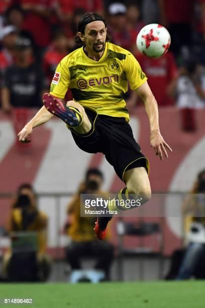 Neven Subotic of Borussia Dortmund in action during the preseason friendly match between Urawa Red Diamonds and Borussia Dortmund at Saitama Stadium...