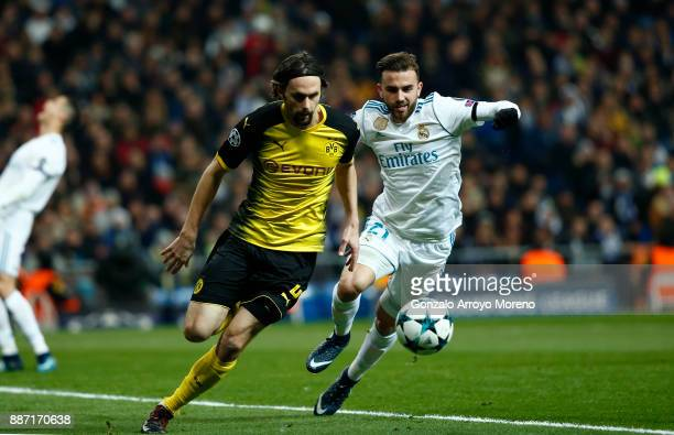 Neven Subotic of Borussia Dortmund is challenged by Borja Mayoral of Real Madrid during the UEFA Champions League group H match between Real Madrid...
