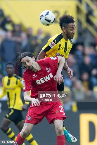 Neven Subotic of Colonge and PierreEmerick Aubameyang of Dortmund battle for the ball during the Bundesliga match between Borussia Dortmund and FC...