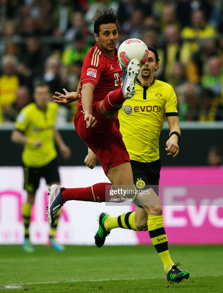 Neven Subotic (R) of Dortmund and Claudio Pizarro of Muenchen compete for the ball during the Bundesliga match between Borussia Dortmund and FC Bayern Muenchen at Signal Iduna Park on May 4, 2013 in Dortmund, Germany.
