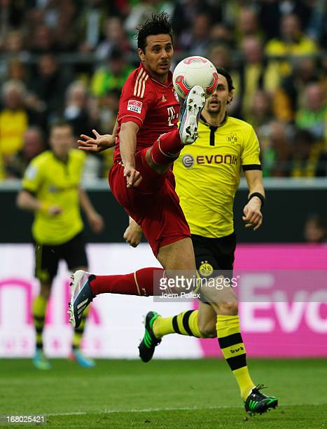 Neven Subotic of Dortmund and Claudio Pizarro of Muenchen compete for the ball during the Bundesliga match between Borussia Dortmund and FC Bayern...