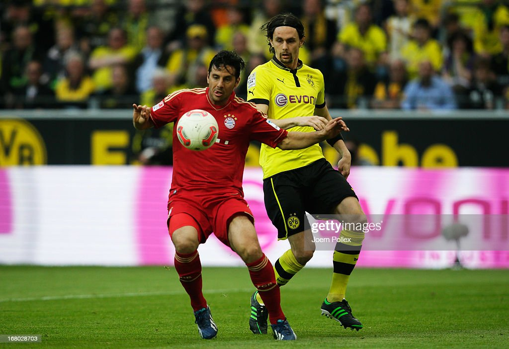 <a gi-track='captionPersonalityLinkClicked' href=/galleries/search?phrase=Neven+Subotic&family=editorial&specificpeople=2234315 ng-click='$event.stopPropagation()'>Neven Subotic</a> (R) of Dortmund and <a gi-track='captionPersonalityLinkClicked' href=/galleries/search?phrase=Claudio+Pizarro&family=editorial&specificpeople=217807 ng-click='$event.stopPropagation()'>Claudio Pizarro</a> of Muenchen compete for the ball during the Bundesliga match between Borussia Dortmund and FC Bayern Muenchen at Signal Iduna Park on May 4, 2013 in Dortmund, Germany.
