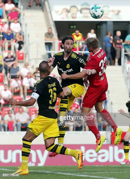 Neven Subotic of Dortmund and Elias Huth of Erfurt and Oemer Toprak of Dortmund battle for the ball during the preseason friendly match between...