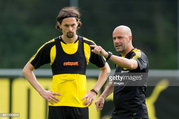 Neven Subotic of Dortmund and Head coach Peter Bosz of Dortmund looks on during a training session as part of the training camp on July 31 2017 in...
