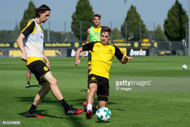 Neven Subotic of Dortmund and Julian Weigl of Dortmund battle for the ball during a training session at the BVB Training center on August 29 2017 in...