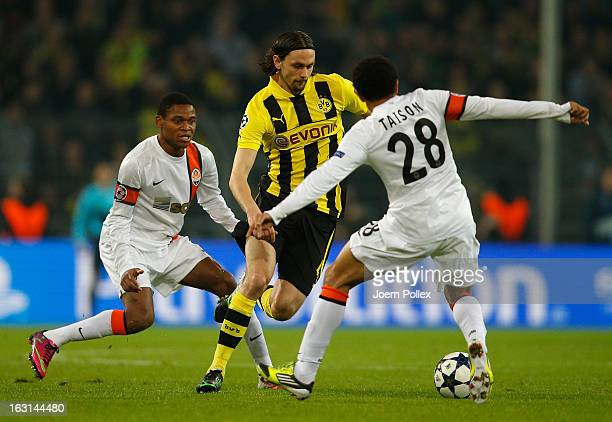 Neven Subotic of Dortmund and Taison of Donetsk compete for the ball during the UEFA Champions League round of 16 leg match between Borussia Dortmund...