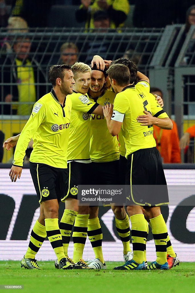 <a gi-track='captionPersonalityLinkClicked' href=/galleries/search?phrase=Neven+Subotic&family=editorial&specificpeople=2234315 ng-click='$event.stopPropagation()'>Neven Subotic</a> of Dortmund (3rd L) celebrates the second goal with <a gi-track='captionPersonalityLinkClicked' href=/galleries/search?phrase=Julian+Schieber&family=editorial&specificpeople=4272399 ng-click='$event.stopPropagation()'>Julian Schieber</a> (L), <a gi-track='captionPersonalityLinkClicked' href=/galleries/search?phrase=Marco+Reus&family=editorial&specificpeople=5445884 ng-click='$event.stopPropagation()'>Marco Reus</a> (2nd L), <a gi-track='captionPersonalityLinkClicked' href=/galleries/search?phrase=Mats+Hummels&family=editorial&specificpeople=595395 ng-click='$event.stopPropagation()'>Mats Hummels</a> (2nd R) and <a gi-track='captionPersonalityLinkClicked' href=/galleries/search?phrase=Sebastian+Kehl&family=editorial&specificpeople=486611 ng-click='$event.stopPropagation()'>Sebastian Kehl</a> (R) of Dortmund during the Bundesliga match between Borussia Dortmund and VfL Borussia Moenchengladbach at Signal Iduna Park on September 29, 2012 in Dortmund, Germany.