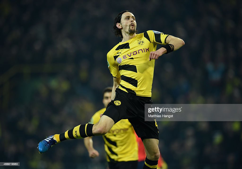 <a gi-track='captionPersonalityLinkClicked' href=/galleries/search?phrase=Neven+Subotic&family=editorial&specificpeople=2234315 ng-click='$event.stopPropagation()'>Neven Subotic</a> of Dortmund celebrates with his team-mates after scoring his team's first goal during during the DFB Cup Quarter Final match between Borussia Dortmund and 1899 Hoffenheim at Signal Iduna Park on April 7, 2015 in Dortmund, Germany.