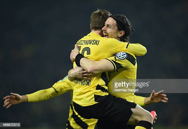 Neven Subotic of Dortmund celebrates with his teammates after scoring his team's first goal during during the DFB Cup Quarter Final match between...