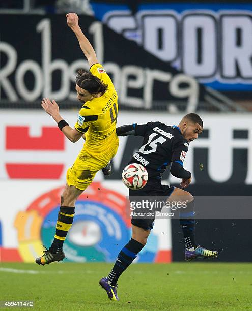 Neven Subotic of Dortmund challenges Elias Kachunga of Paderborn in an aerial duel during the Bundesliga match between SC Paderborn 07 and Borussia...
