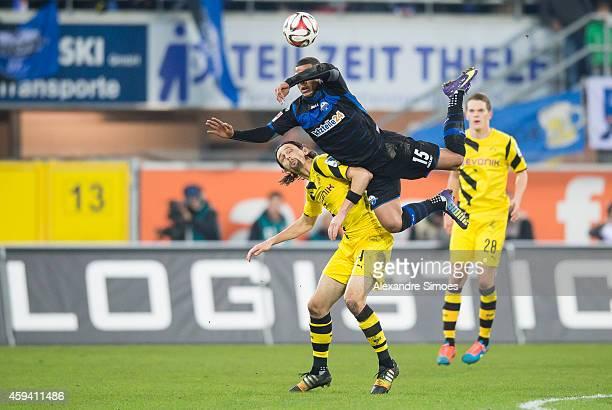 Neven Subotic of Dortmund challenges Elias Kachunga of Paderborn during the Bundesliga match between SC Paderborn 07 and Borussia Dortmund at...
