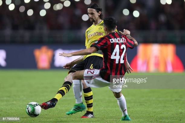 Neven Subotic of Dortmund in action against Giovanni Crociata of AC Milan during the 2017 International Champions Cup football match between AC Milan...
