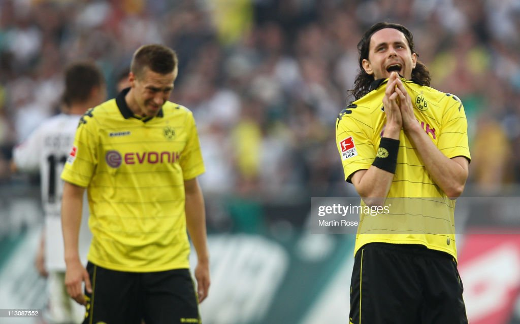 <a gi-track='captionPersonalityLinkClicked' href=/galleries/search?phrase=Neven+Subotic&family=editorial&specificpeople=2234315 ng-click='$event.stopPropagation()'>Neven Subotic</a> of Dortmund looks dejected after the Bundesliga match between Borussia Moenchengladbach and Borussia Dortmund at Borussia Park on April 23, 2011 in Moenchengladbach, Germany.