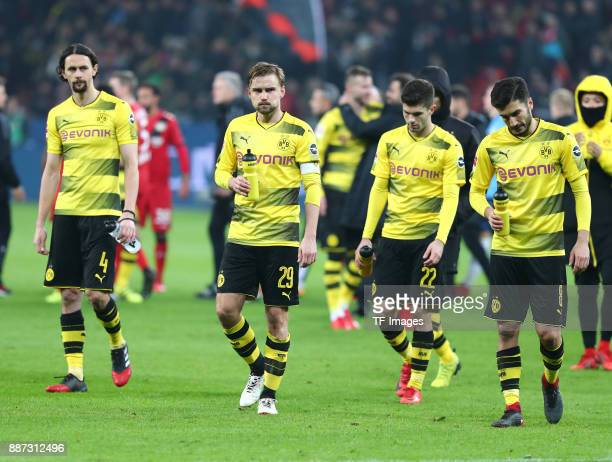 Neven Subotic of Dortmund Marcel Schmelzer of Dortmund Christian Pulisic of Dortmund and Nuri Sahin of Dortmund look dejected after the Bundesliga...