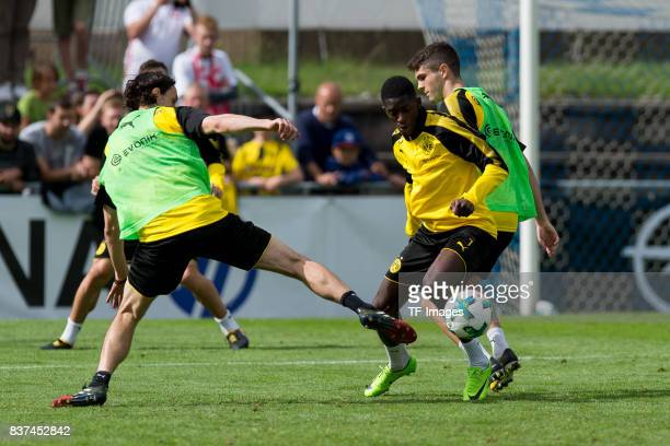 Neven Subotic of Dortmund Ousmane Dembele of Dortmund and Christian Pulisic of Dortmund battle for the ball during a training session as part of the...