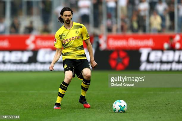 Neven Subotic of Dortmund runs with the ball during the preseason friendly match between RotWeiss Essen and Borussia Dortmund at Stadion Essen on...
