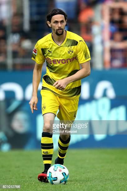 Neven Subotic of Dortmund runs with the ball during the preseason friendly match between VfL Bochum and Borussia Dortmund at Vonovia Ruhrstadion on...