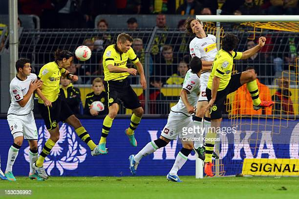 Neven Subotic of Dortmund scores the second goal during the Bundesliga match between Borussia Dortmund and VfL Borussia Moenchengladbach at Signal...