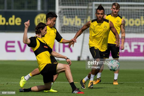Neven Subotic of Dortmund Shinji Kagawa of Dortmund and PierreEmerick Aubameyang of Dortmund battle for the ball during a training session at the BVB...